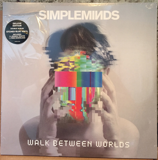 jaquettes4/Simple-Minds_Walk-Between-Worlds_etched-blue-vinyl.jpg